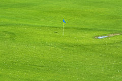 Vibrant golf course and target flag Royalty Free Stock Image