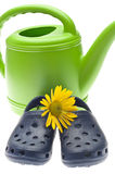 Vibrant Green Watering Can with Yellow Daisy Royalty Free Stock Photography