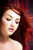 Vibrant hair. A young woman with her multicolored hair blowing in the wind royalty free stock image