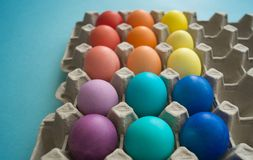 Vibrant hand dyed colorful Easter eggs in a cardboard egg box viewed royalty free stock image