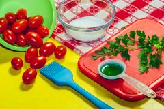 A yellow kitchen table with ingredients Royalty Free Stock Photo