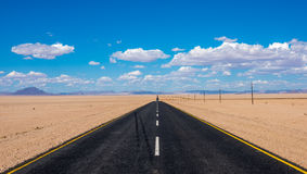 Vibrant image of highway and blue cloudy sky Royalty Free Stock Photos