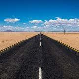 Vibrant image of highway and blue cloudy sky Royalty Free Stock Photo