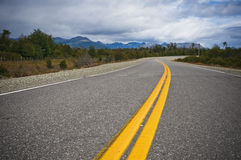 Vibrant image of highway and blue sky Royalty Free Stock Photo