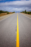 Vibrant image of highway and blue sky. Image of highway and blue sky Stock Photography