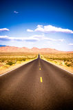 Vibrant image of highway and blue sky Stock Image