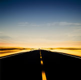 Vibrant image of highway and blue sky. In motion blur Royalty Free Stock Image