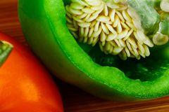 A Vibrant Macro image of a Green Bell Pepper sliced with the seed stock image