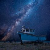 Vibrant Milky Way composite image over landscape of Abandoned fi. Stunning vibrant Milky Way composite image over landscape of Abandoned fishing boat on shingle Royalty Free Stock Photos