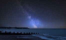 Vibrant Milky Way composite image over landscape of pier under construction and development. Stunning vibrant Milky Way composite image over landscape of pier stock images