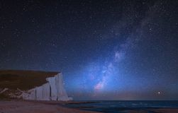 Vibrant Milky Way composite image over landscape of Seven Sister Stock Images