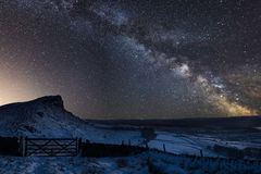 Vibrant Milky Way composite image over landscape of snow covered. Stunning vibrant Milky Way composite image over landscape of snow covered Peak District stock photos
