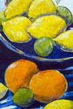 Original oil painting close up detail - lemons and limes. Vibrant multi-colored original oil painting close up detail showing brushwork and canvas textures stock photography