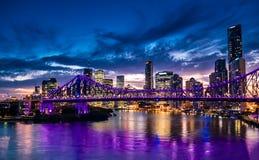 Vibrant night time panorama of Brisbane city with purple lights. On Story Bridge, Australia Stock Photo