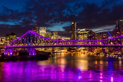 Vibrant night time panorama of Brisbane city with Story Bridge. Vibrant night time panorama of Brisbane city with purple lights on Story Bridge, Australia Stock Photography
