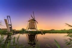 Vibrant night windmill Stock Photo