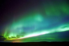 Vibrant. Northern lights shows over farmland Royalty Free Stock Photography