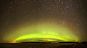 Vibrant. Northern lights shows over farmland Stock Photos