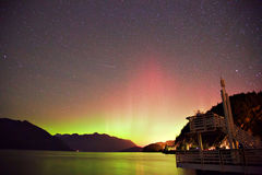 Vibrant. Northern lights shows over mountains Stock Images