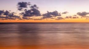 Vibrant Orange Sunset on Tropical Island Royalty Free Stock Images