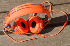 Vibrant orange wired headphones Stock Photo