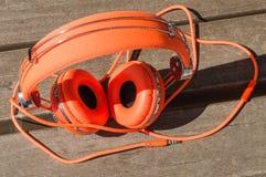 Vibrant orange wired headphones Stock Photo