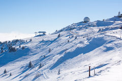 Vibrant panorama of the slopes at ski resort Kopaonik, Serbia, snow trees, blue sky. Vibrant panorama of the slope at ski resort Kopaonik, Serbia, snow pine Stock Photo