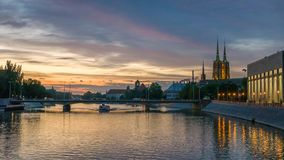 Vibrant panorama of Wroclaw and Odra river over vivid sunset Stock Photography