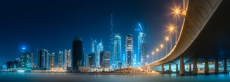 Panoramic view of Dubai Business bay, UAE. Vibrant panoramic view of Dubai Business bay at evening light, UAE royalty free stock images