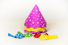 Vibrant party hats and balloons Stock Image