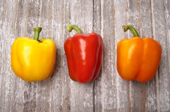 Vibrant Peppers on Rustic Wood Stock Photos