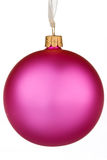 Vibrant pink Christmas Bauble. On isolated white Stock Photos