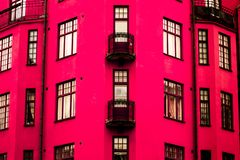 A vibrant pink house. With windows and balconies stock photo