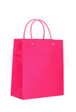 Vibrant Pink Shopping Bag. A bright pink glossy shopping bag, isolated on white stock photo