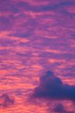 Vibrant purple clouds sunset Royalty Free Stock Photo