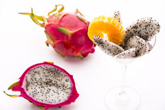 Vibrant purple fruit with white pulp: Pitaya. This tropical fruit has a vibrant purple skin and a creamy, white pulp. It is imported from Mexico, Nacaragua Royalty Free Stock Photography