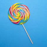 Vibrant Rainbow Lolly Pop. On a Blue Background Royalty Free Stock Photography