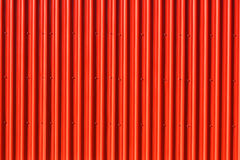 Vibrant red Aluminum Siding - vertical Stock Photo
