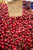 Vibrant red cherries for sale Stock Photography