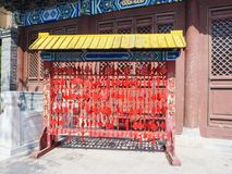 Vibrant red Chinese wishing cards hanging on a rack royalty free stock photography