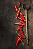 Vibrant red mexican hot chilli pepper. On old background Royalty Free Stock Photo