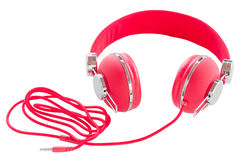 Vibrant red wired headphones isolated. On white background royalty free stock photography