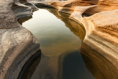 Vibrant Rock. Shadow of vibrant rock in the water show the beauty of nature Royalty Free Stock Photo