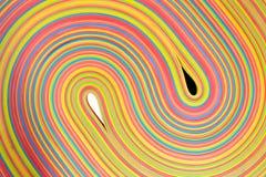 Rubber strips yin yang pattern. Vibrant rubber strips arranged in yin-yang pattern Stock Photos
