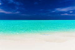 A vibrant shot of clear empty beautiful tropical beach Stock Photo