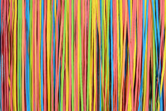 Small rubberband strips pattern. Vibrant small rubber strips arranged in vertical pattern, horizontal frame Stock Image