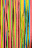 Small rubberband strips vertical pattern. Vibrant small rubber strips arranged in vertical pattern, vertical frame Royalty Free Stock Photos