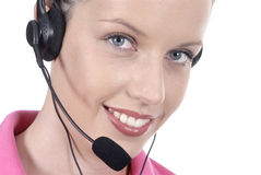 Female woman telephonist, telephone headset, close up, looking at camera, white background Royalty Free Stock Images