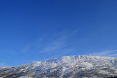 Vibrant snowy mountain peak at sunrise Royalty Free Stock Photo