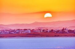 Vibrant and soften view of nice sunset over dry salt lake in Cyprus Larnaca in summer. With multilevel background stock photo